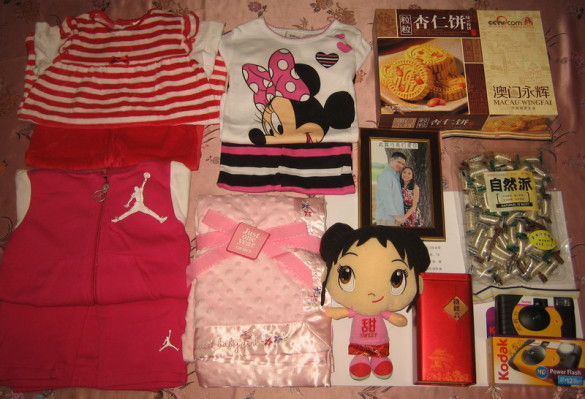 3 outfits, a blanket, a Kai Lan doll, 2 disposable digital cameras, a framed pic of us, and cookies, tea, candy and fruit (not pictured) for her foster parents