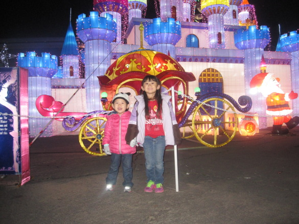 Roxy and her friend standing in front of the castle