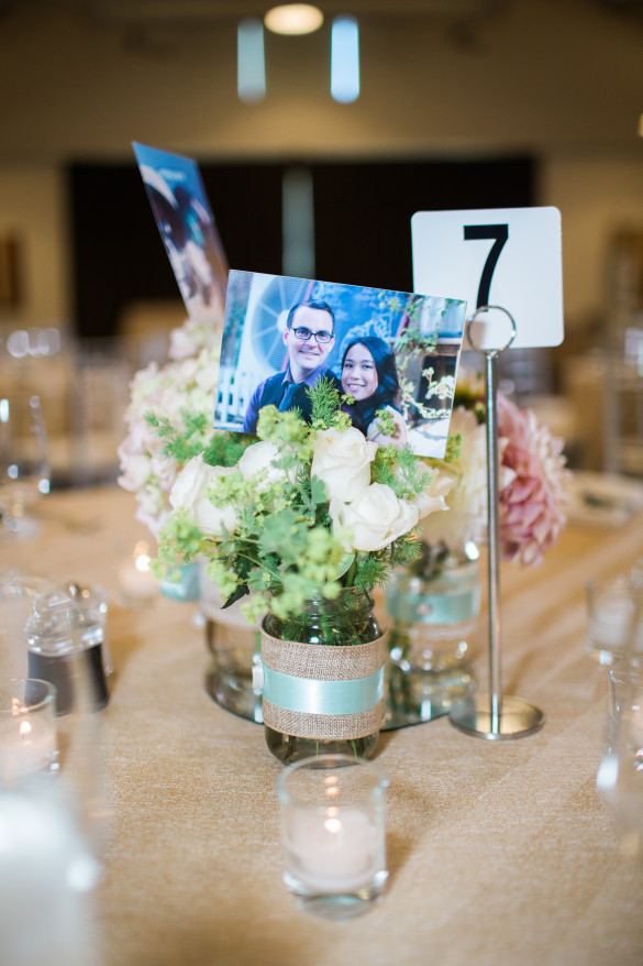 The tables with centerpieces handmade by Daisy M Productions