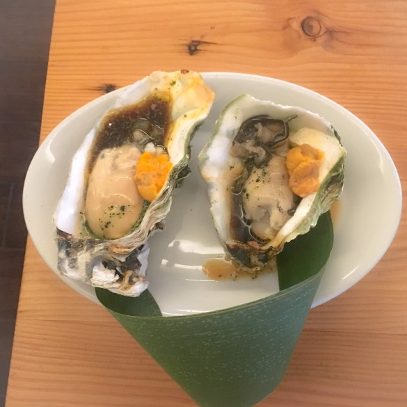 Grilled Oysters with soy, butter, and uni