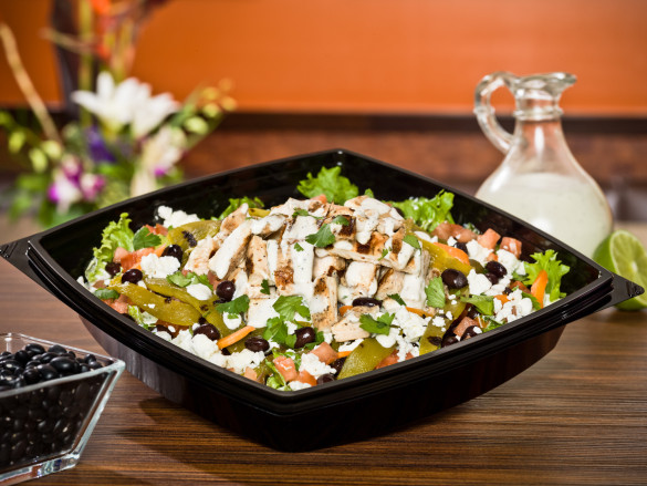 Hatch Chile Chicken Salad with lime-marinated, chargrilled chicken breast on top of hand-cut greens with feta cheese, diced tomatoes, carrots, black beans, chargrilled sliced Hatch chiles and fresh cilantro, tossed in our house-made cilantro lime ranch dressing
