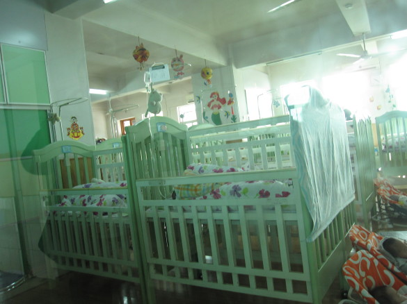 An Infant Room at the Wuhan Municipal Children's Welfare Institute.