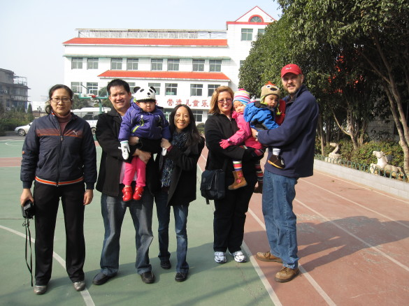 With another Holt family and one of the Directors of the Wuhan Municipal Children's Welfare Institute