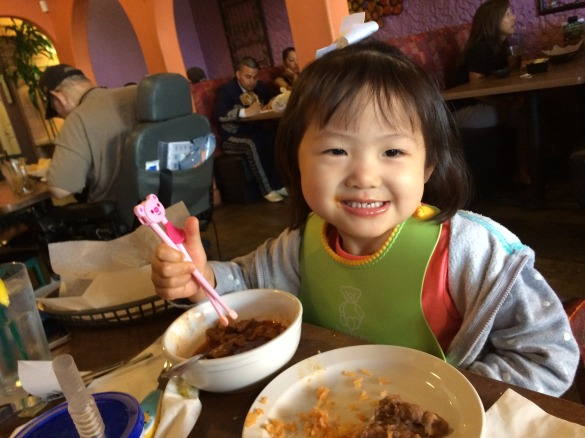 """""""Mama, I eat pozole with chopsticks!"""" Roxy has no idea why but I credit my Mexican god family for moments like this."""