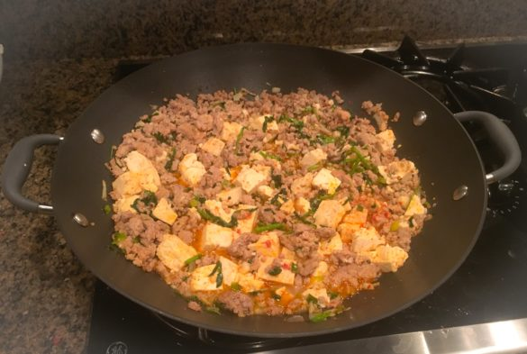 Mapo Tofu made with lean ground pork, tofu, and watercress